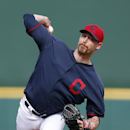 Cleveland Indians pitcher John Axford throws against the Chicago White Sox during an exhibition baseball game in Goodyear, Ariz., Tuesday, March 4, 2014 The Associated Press