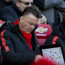 Manchester United's manager Louis van Gaal takes his seat before his team's English Premier League soccer match between Manchester United and Leicester at Old Trafford Stadium, Manchester, England, Saturday Jan. 31, 2015