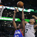 Boston Celtics center Jared Sullinger (7) and Philadelphia 76ers forward Jarvis Varnado (40) vie for a rebound during the second quarter of an NBA basketball game Friday, April 4, 2014, in Boston The Associated Press