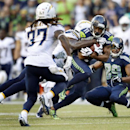 Seattle Seahawks wide receiver Percy Harvin (11) is tackled after a reception in the first half of a preseason NFL football game against the San Diego Chargers, Friday, Aug. 15, 2014, in Seattle The Associated Press