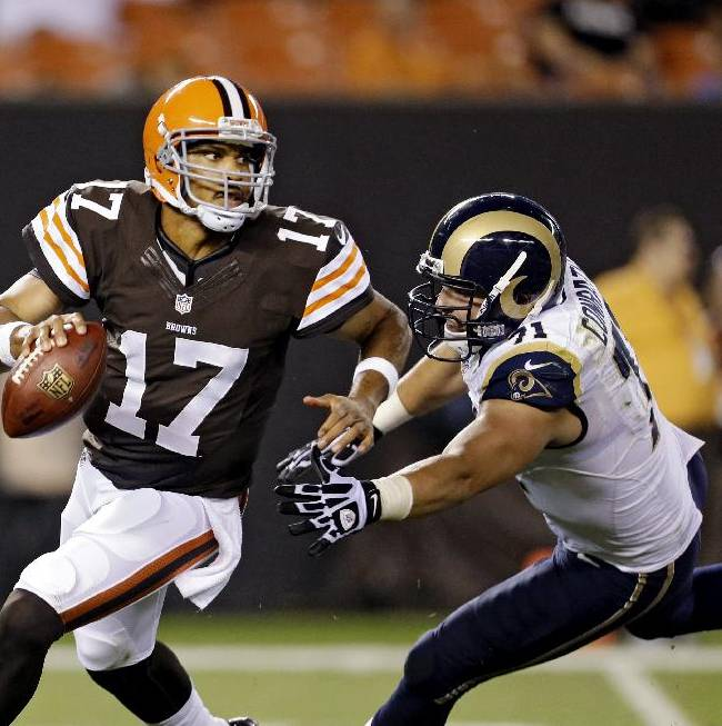 In this Aug. 8, 2013 file photo, Cleveland Browns quarterback Jason Campbell (17) is chased by St. Louis Rams' Matt Conrath in the second quarter of a preseason NFL football game, in Cleveland. Browns backup quarterback Jason Campbell will replace struggling Brandon Weeden and start on Sunday in Kansas City