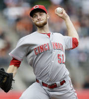 Cincinnati Reds starting pitcher Tony Cingrani throws to the San Francisco Giants during the first inning of the first game of a baseball doubleheader on Tuesday, July 23, 2013, in San Francisco. (AP Photo/Marcio Jose Sanchez)