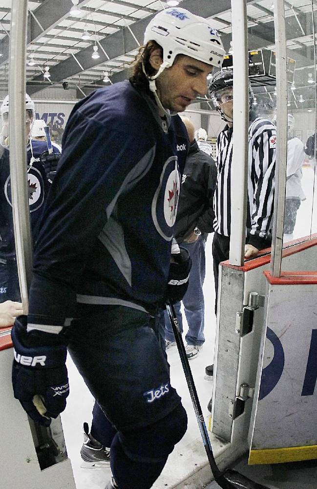 Winnipeg Jets' Chris Thorburn (22) leads his group off the ice at NHL hockey training camp Thursday, Sept. 12, 2013, in Winnipeg, Manitoba