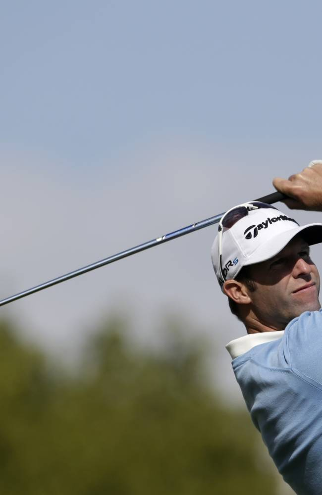 Bradley Dredge from Wales tees off during the golf Czech Masters European Tour Event in Vysoky Ujezd, Czech Republic, Sunday, Aug. 24, 2014