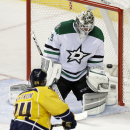 Nashville Predators left wing Eric Nystrom (24) scores against Dallas Stars goalie Anders Lindback (29), of Sweden, in the third period of an NHL hockey game Saturday, Oct. 11, 2014, in Nashville, Tenn The Associated Press