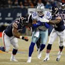 Dallas Cowboys tight end Jason Witten (82) is tackled by Chicago Bears inside linebacker Jon Bostic (57) and inside linebacker Christian Jones (59) during the first half of an NFL football game Thursday, Dec. 4, 2014, in Chicago The Associated Press