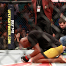 Anderson Silva, who kneels on the mat after beating Nick Diaz in a middleweight bout during UFC 183 at the MGM Grand Garden Arena on Jan. 31 in Las Vegas, failed yet another drug test given by the Nevda Athletic Commission. (Photo by Steve Marcus/Getty Images)