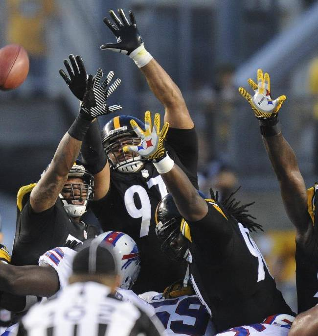 Pittsburgh Steelers defensive end Cameron Heyward (97) and the Steelers field goal defense leap to block a field goal by Buffalo Bills kicker Dustin Hopkins in the first quarter of an NFL football preseason game on Saturday, Aug. 16, 2014 in Pittsburgh. The kick was good