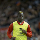 Liverpool substitute Mario Balotelli warms up during the English League Cup soccer match between Liverpool and Swansea at Anfield Stadium, Liverpool, England, Tuesday Oct. 28, 2014
