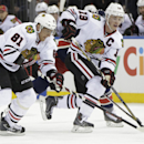 Chicago Blackhawks right wing Marian Hossa (81), of Slovakia, and center Jonathan Toews (19) move the puck down the ice during the first period of an NHL hockey game against the New York Rangers at Madison Square Garden in New York, Thursday, Feb. 27, 201