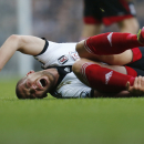 Fulham s Pajtim Kasami screams as he lies on the ground following a foul by a West Ham player during their English Premier League soccer match in London, Saturday, Nov. 30, 2013