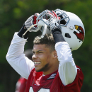 Arizona Cardinals rookie Tyrann Mathieu takes his helmet off during practice in the 100-degree heat at the Cardinals training facility on Tuesday, May 14, 2013, in Tempe, Ariz. (AP Photo/Ross D. Franklin)