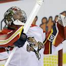 Florida Panthers goalie Tim Thomas (34) looks up after time runs out and the Panthers defeat the Detroit Red Wings 2-1 in an NHL hockey game in Detroit, Saturday, Dec. 7, 2013. (AP Photo/Carlos Osorio)