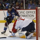 Florida Panthers goalie Roberto Luongo, front, makes glove save of shot off the stick of Colorado Avalanche center Ryan O'Reilly in the first period of an NHL hockey game in Denver on Tuesday, Oct. 21, 2014 The Associated Press