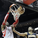 Houston Rockets' Dwight Howard (12) scores two points against Indiana Pacers' Luis Scola (4) in the first half of an NBA basketball game on Friday, March 7, 2014, in Houston The Associated Press