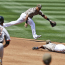 San Diego Padres second baseman Alexi Amarista, right, and shortstop Everth Cabrera, top, cannot reach a single by San Francisco Giants' Brandon Crawford as Giants baserunner Brandon Hicks (14) races around the bases to third in the second inning of a bas