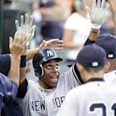 In this Aug. 6, 2012 file photo, New York Yankees' Curtis Granderson celebrates in the dugout after scoring on a double by Robinson Cano in the fifth inning of a baseball game against the Detroit Tigers, in Detroit. A person familiar with the situation sa