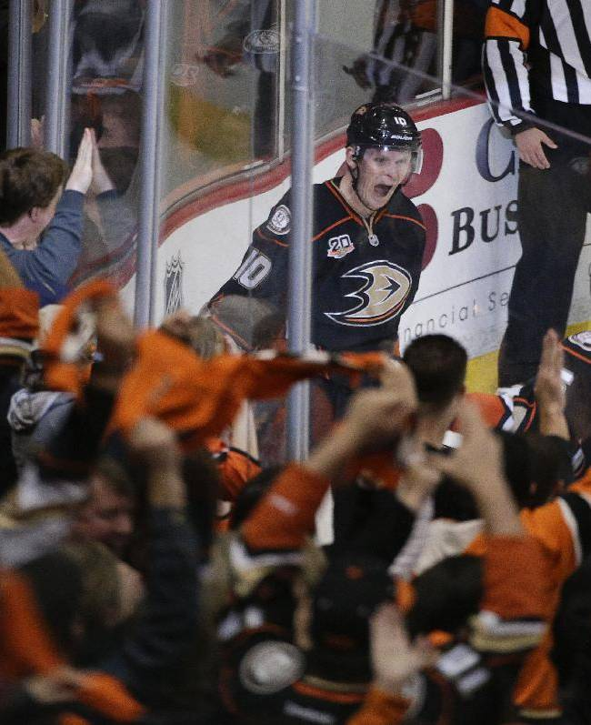 The fans cheer as Anaheim Ducks' Corey Perry, center, and Ryan Getzlaf celebrate a goal by Perry during the second period in Game 2 of the first-round NHL hockey Stanley Cup playoff series against the Dallas Stars on Friday, April 18, 2014, in Anaheim, Calif
