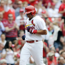 St. Louis Cardinals' Jhonny Peralta scores on a two RBI single by teammate Matt Carpenter against the Chicago Cubs in the second inning of a baseball game, Sunday, April 13, 2014, at Busch Stadium in St. Louis The Associated Press