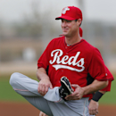 Cincinnati Reds left fielder Ryan Ludwick stretches during spring training baseball practice in Goodyear, Ariz., Tuesday, Feb. 25, 2014 The Associated Press