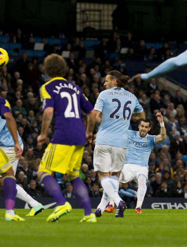 Manchester City's Alvaro Negredo, second right, scores against Swansea City during their English Premier League soccer match at the Etihad Stadium, Manchester, England, Sunday Dec. 1, 2013