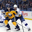 Buffalo Sabres' Brian Flynn (65) controls the puck against Tampa Bay Lightning's Victor Hedman (77), of Sweden, during the third period of an NHL hockey game Tuesday, Dec. 2, 2014, in Buffalo, N.Y. Buffalo defeated Tampa Bay 2-1 The Associated Press