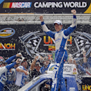 Driver Brad Keselowski celebrates after winning the NASCAR UNOH 200 Truck Series auto race on Thursday, Aug. 21, 2014, in Bristol, Tenn. (AP Photo/Wade Payne)