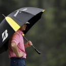 Brandt Snedeker peers from under his umbrella on the third hole during the fourth round of the Masters golf tournament Sunday, April 14, 2013, in Augusta, Ga. (AP Photo/Matt Slocum)