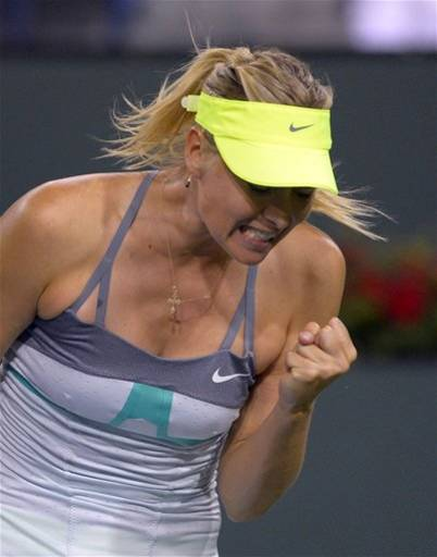 Maria Sharapova, of Russia, reacts after winning a point over Maria Kirilenko, of Russia, in their semifinal match at the BNP Paribas Open tennis tournament, Friday, March 15, 2013, in Indian Wells, Calif