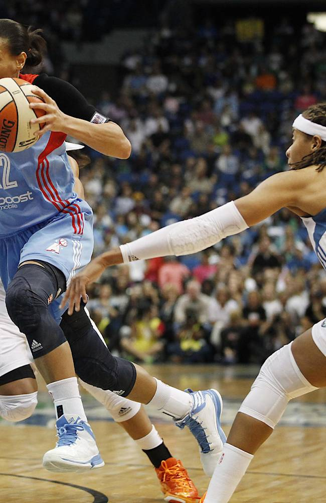 Atlanta Dream guard Armintie Herrington (22) pushes the ball past Minnesota Lynx guard Seimone Augustus (33) during the first half of Game 2 of the WNBA basketball finals, Tuesday, Oct. 8, 2013, in Minneapolis