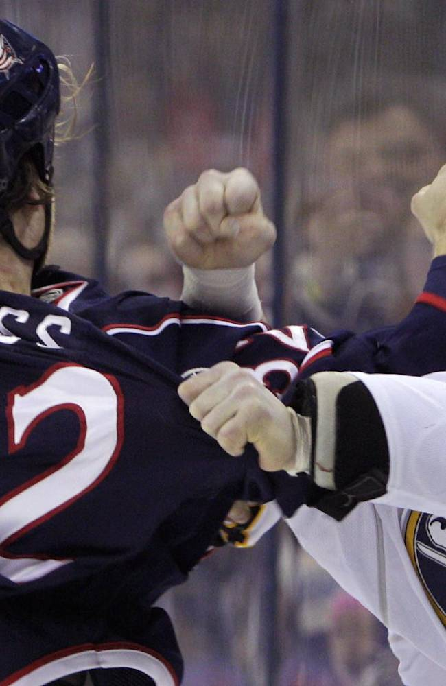 Columbus Blue Jackets' Cody Bass, left, and Buffalo Sabres' Zenon Konopka fight during the first period of an NHL hockey game, Saturday, Jan. 25, 2014, in Columbus, Ohio