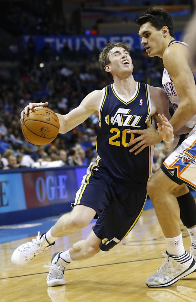 Utah Jazz forward Gordon Hayward (20) is fouled by Oklahoma City Thunder' Steven Adams (12) as he drives to the basket during the third quarter of a preseason NBA basketball game in Oklahoma City, Sunday, Oct. 20, 2013. Oklahoma City won 88-82