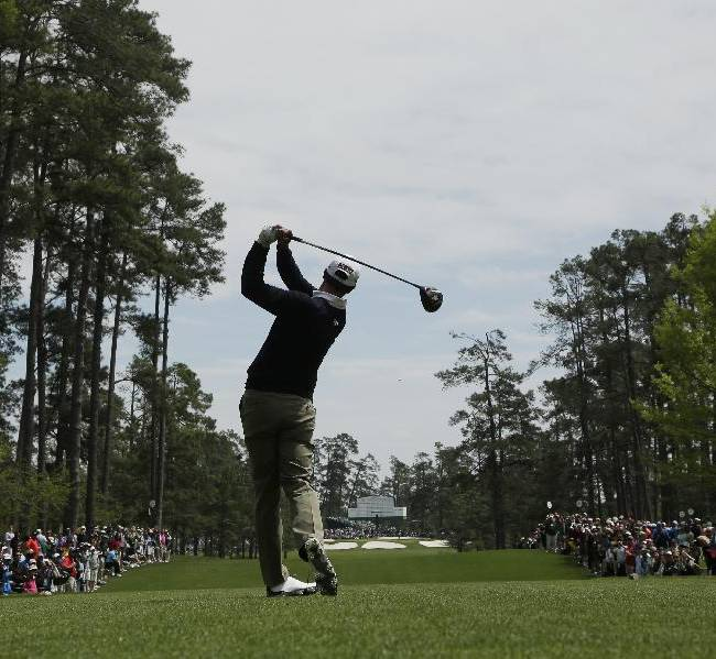 Adam Scott, of Australia, tees off on the seventh hole during a practice round for the Masters golf tournament Tuesday, April 8, 2014, in Augusta, Ga