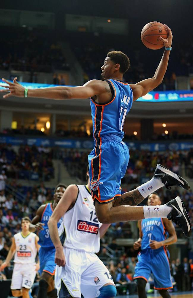 Oklahoma City Thunder's Jeremy Lamb shoots during a basketball game with Fenerbahce Ulker in Istanbul, Turkey, Saturday, Oct. 5, 2013.  Oklahoma City Thunder has opened the preseason schedule with a game against the five-time Turkish champions at the Ulker Sports Arena. (AP Photo)