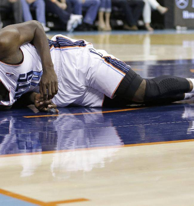 Charlotte Bobcats' Michael Kidd-Gilchrist lays on the court in pain after being injured during the first half of an NBA basketball game against the Orlando Magic in Charlotte, N.C., Friday, April 4, 2014
