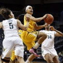 California's Brittany Boyd, center, drives between Oregon's Jordan Loera, left, and Jillian Alleyne during the second half in an NCAA college basketball game in Eugene, Ore., Sunday Feb. 3, 2013. (AP Photo/Chris Pietsch)