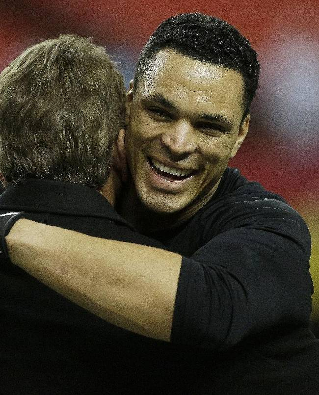 Atlanta Falcons tight end Tony Gonzalez, right, speaks with former NFL football player Joe Theismann speaks with works out before the first half of an NFL football game Carolina Panthers, Sunday, Dec. 29, 2013, in Atlanta. Gonzales possibly plans to retire after this season