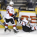 Ottawa Senators defenseman Erik Karlsson, of Sweden, falls to the ice as he fights for the puck with teammate Zack Smith (15) and Nashville Predators' Colin Wilson (33), Olli Jokinen (13), of Finland, and Calle Jarnkrok (19), of Sweden, in the second peri
