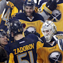 Buffalo Sabres' Tyler Ennis (63), Matt Moulson (26) and goaltender Jhonas Enroth, left, celebrate along the glass with Nikita Zadorov (51) after Zadorov scored the game-winning goal against the Florida Panthers during the overtime session of an NHL hockey