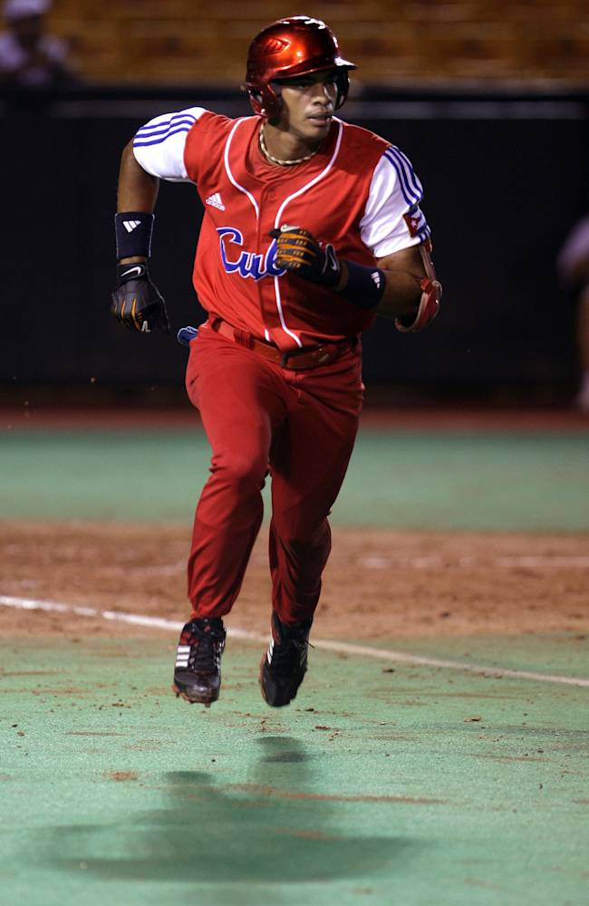 In this Oct. 4, 2010 file photo, Cuba's Yulieski Gourriel runs to first base after hitting against Nicaragua during a Baseball World Cup qualifier game in Carolina, Puerto Rico. A top active player in Cuba's National Series, second and third baseman Gourriel hit .314 last season. Cuba on Friday, Sept. 27, 2013 announced that athletes from all sports will soon be able to ply their trade in foreign leagues