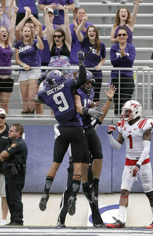 TCU wide receiver Ty Slanina (13) is congratulated by teammate and wide receiver Josh Doctson (9) after scoring a touchdown as SMU defensive back Chris Parks (1) looks on during the second half of an NCAA college football game Saturday, Sept. 28, 2013, in Fort Worth, Texas. TCU won 48-17