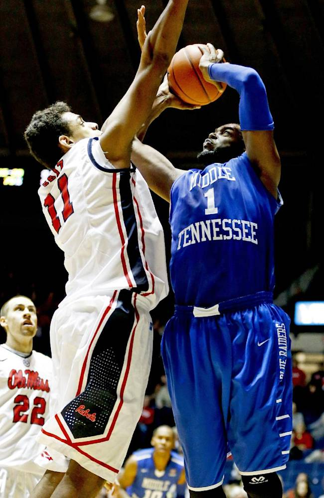 Middle Tennessee State forward Neiko Hunter (1) tries to shoot over Mississippi forward Sebastian Saiz (11) in the second half of an NCAA college basketball game in Oxford, Miss., Saturday, Dec. 14, 2013. Mississippi won 72-63