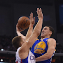 Golden State Warriors guard Klay Thompson, right, puts up a shot as Los Angeles Clippers forward Blake Griffin defends during the second half in Game 1 of an opening-round NBA basketball playoff series, Saturday, April 19, 2014, in Los Angeles. The Warrio