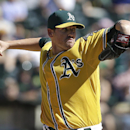 Oakland Athletics pitcher Dan Straily throws against the Houston Astros during the seventh inning of a baseball game in Oakland, Calif., Saturday, Sept. 7, 2013. (AP Photo/Jeff Chiu)