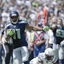 Seattle Seahawks wide receiver Percy Harvin appears to step out of bounds while running for a touchdown as San Diego Chargers cornerback Richard Marshall defends during the first half of an NFL football game on Sunday, Sept. 14, 2014, in San Diego. (AP Photo/Gregory Bull)
