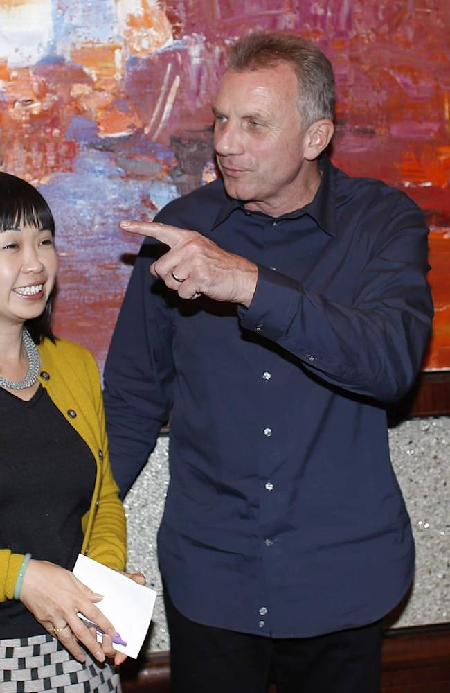 NFL Legend and Hall of Fame Quarterback Joe Montana chats with a Chinese fan during a NFL promotional event called