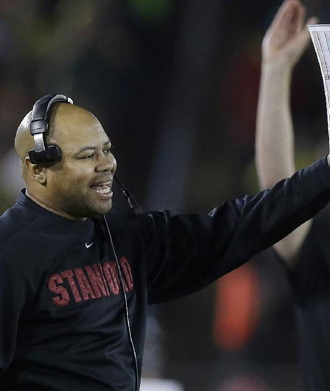 Stanford head coach David Shaw yells from the sideline during the first quarter of an NCAA college football game against Oregon in Stanford, Calif., Thursday, Nov. 7, 2013
