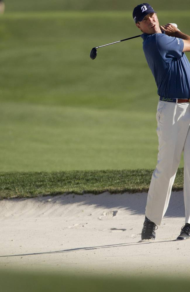 Matt Kuchar takes his second shot from a bunker on the eighteenth hole during the second round of the Houston Open golf tournament on Friday, April 4, 2014, in Humble, Texas. (AP Photo/Patric Schneider)