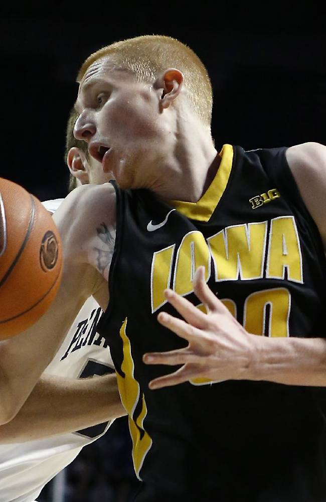 Iowa's Aaron White, right, is held by Penn State's Jack Donovan during the second half of an NCAA college basketball game on Saturday, Feb. 15, 2014, in State College. No foul was called on the play. Iowa won 82-70