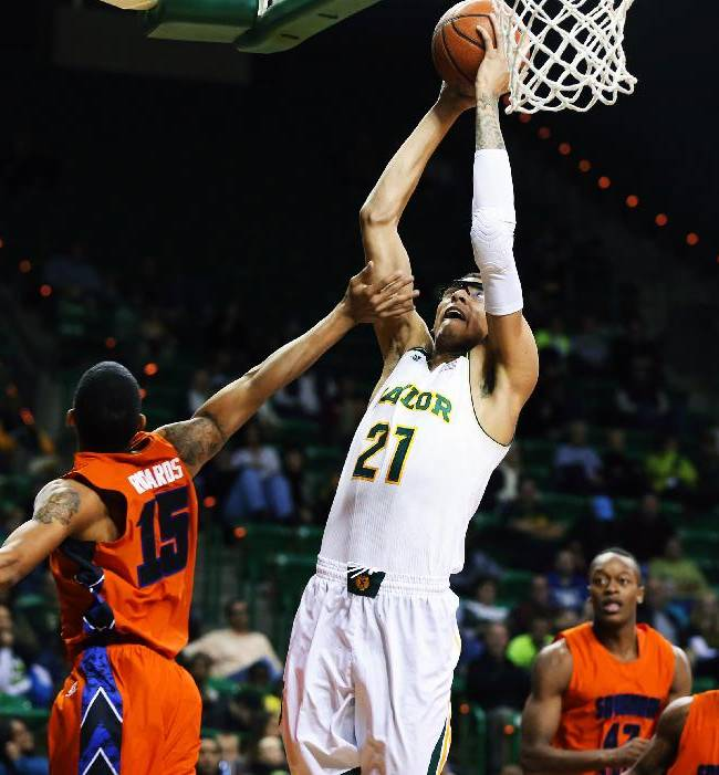 Baylor center Isaiah Austin (21) shoots over Savannah State guard Keierre Richards, left, during the second half of an NCAA college basketball game, Friday, Jan. 3, 2014, in Waco, Texas